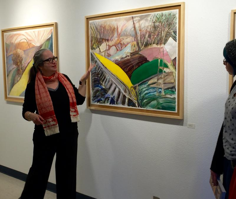 Artist Emily Düwel explains her work to students and members of the public at Arizona Western College's art gallery in Yuma.