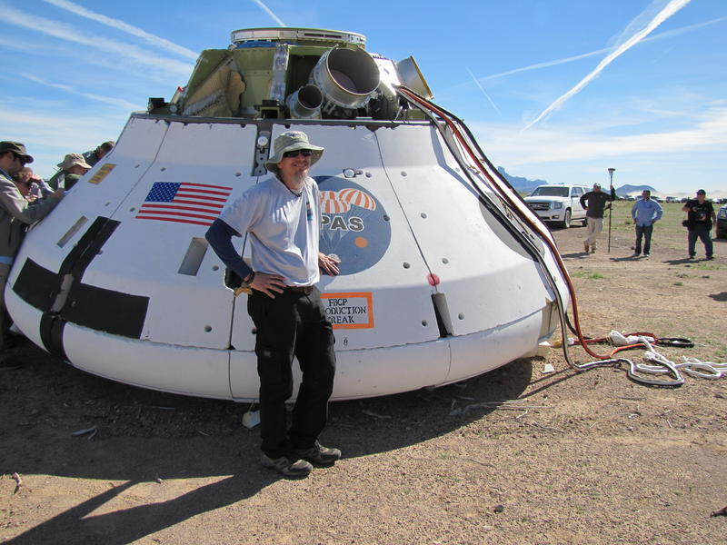 Koki Machin and the landed Orion Test Capsule