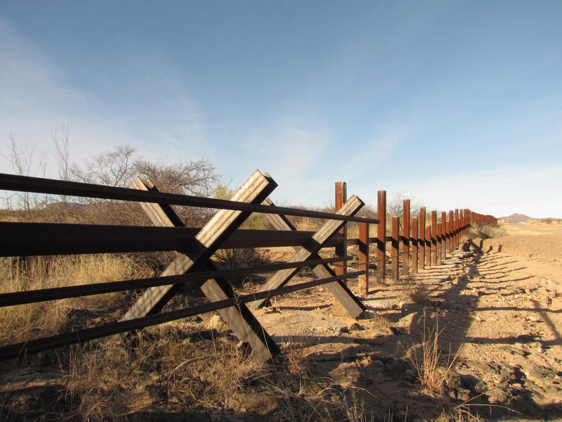 The Normandy barrier meets the post-on-rail fence at the Douglas, AZ border