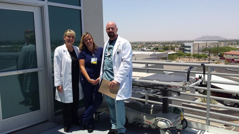 Left to Right: Dr. Sarah Sullivan, BSN Micaela Prevatke, & Dr. Greg Baker at the YRMC Helipad