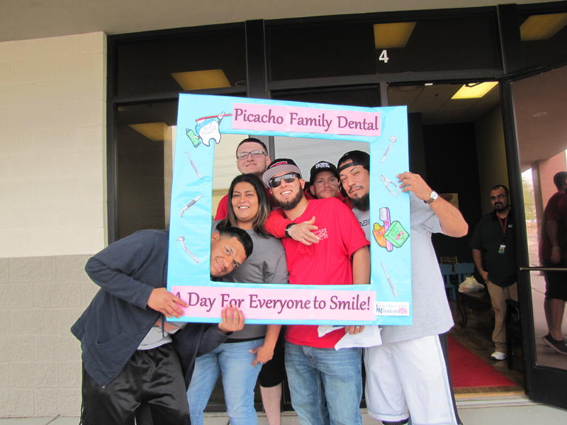 Alanna Limon and Crossroads Mission dental patients outside Picacho Family Dental