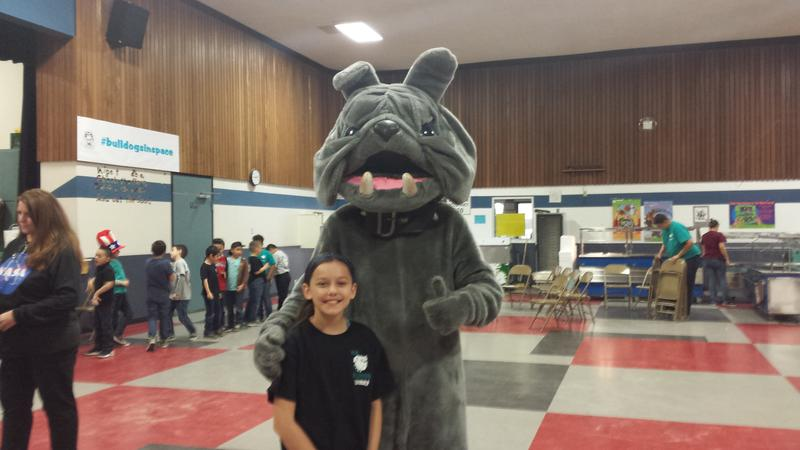 5th-grader Adrienne Rice and the H. L. Suverkrup Bulldog after the Downlink