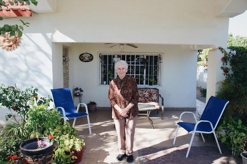 My grandmother Maria Antonia Avendaño Bazua stands at her front porch in Los Algodones.