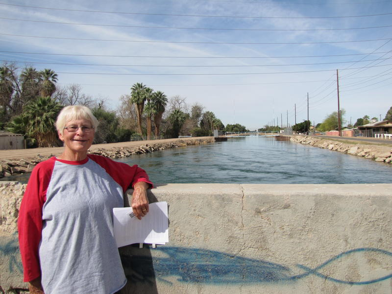 "Roberta ""Bobbi"" Stevenson-McDermott stands beside a Yuma canal of Colorado River water"