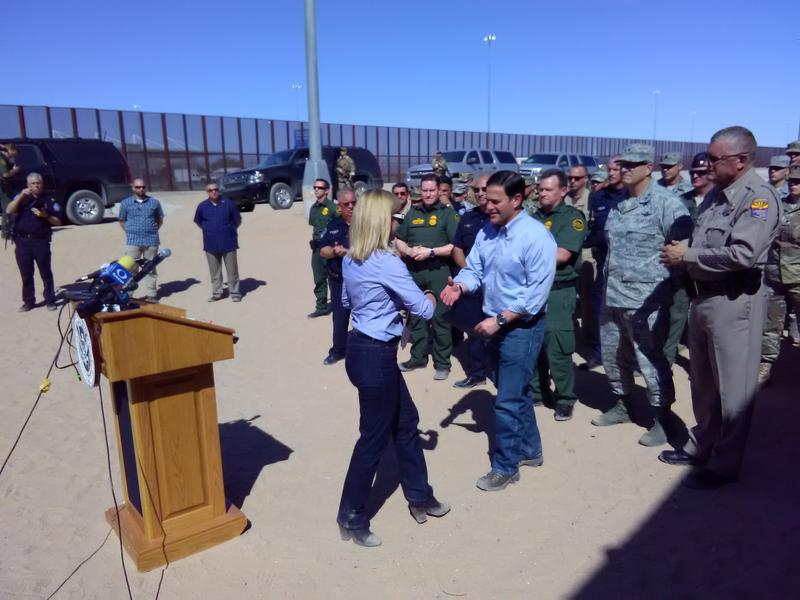Secretary Nielsen shaking hands with Arizona Governor Doug Ducey on the U.S./Mexico border near Yuma, Arizona