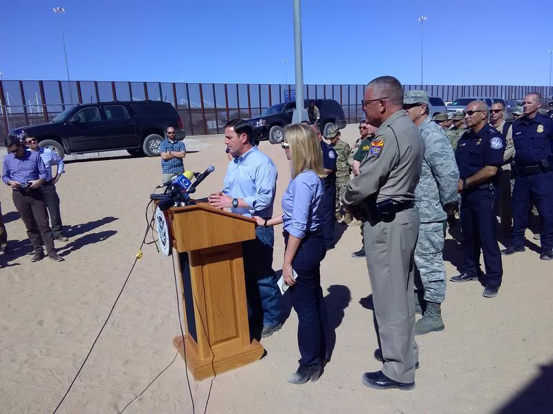 Arizona Governor Doug Ducey speaking on the U.S./Mexico border near Yuma, Arizona