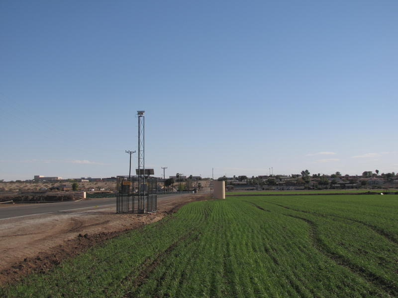 A Large Aperture Scintillometer stands beside a field planted with durum wheat