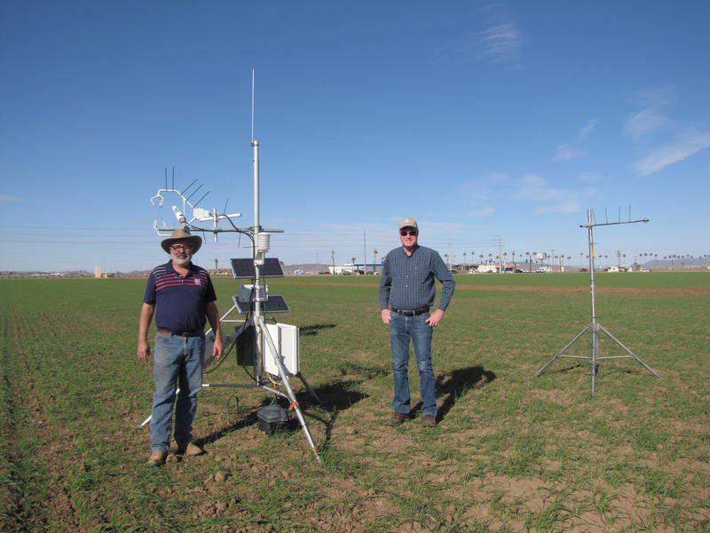 Dr. Charles Sanchez (Left) and Paul Brierley of YCEDA (Left) stand in a Smith Farms durum wheat field next to an Eddy Covariance System