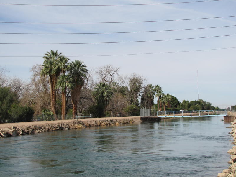 A canal of Colorado River water flows through Yuma, Arizona