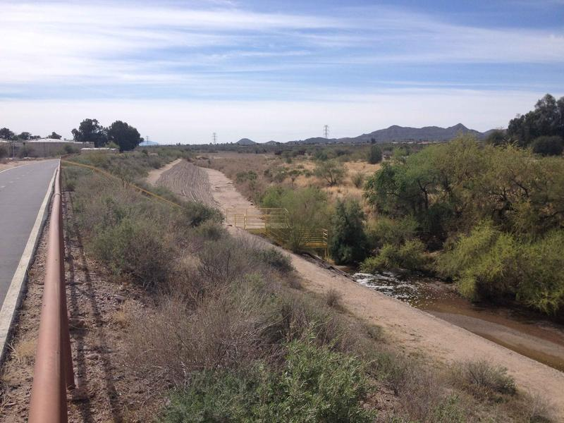 The Santa Cruz river is dry (left) upstream of the outflow of the Agua Dulce wastewater treatment plant on Tucson's northwest side
