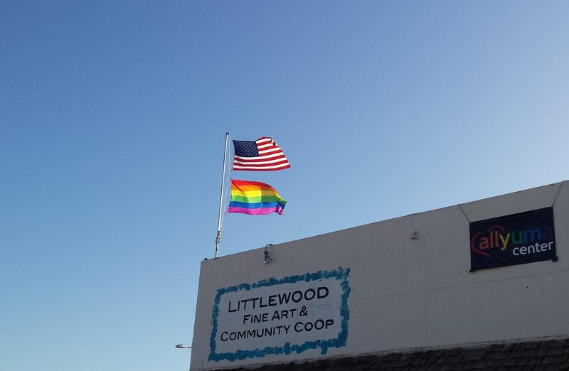 The American Flag and the LGBTQ Flag Flying over the Littlewood CoOp