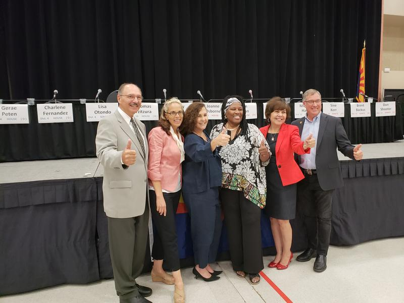 Democratic candidates Thomas Tzitzura, Michelle Harris, Lisa Otondo, Gerae Peten and Charlene Fernandez pose for photos after a candidate forum at the Yuma Civic Center on Thursday, August 2, 2018.