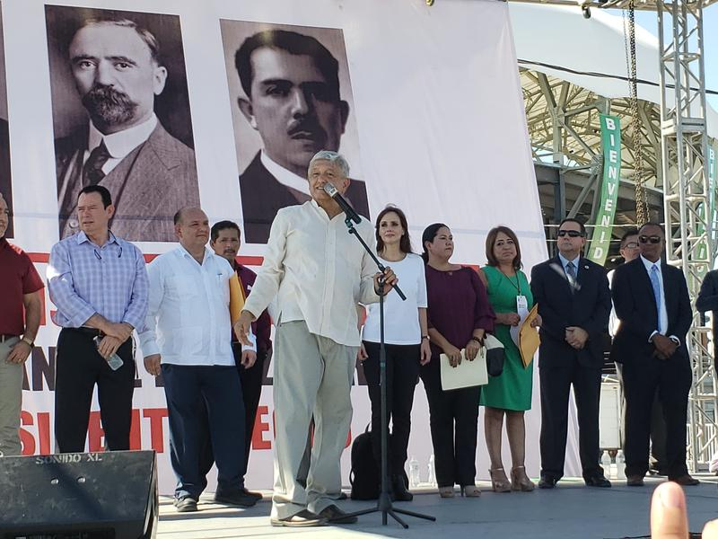 Mexico's President-Elect Andres Manuel Lopez Obrador speaks at a rally in San Luis Rio Colorado on September 21, 2018. On the right are Yuma Mayor Doug Nicholls and Somerton Mayor Jose Yepez.
