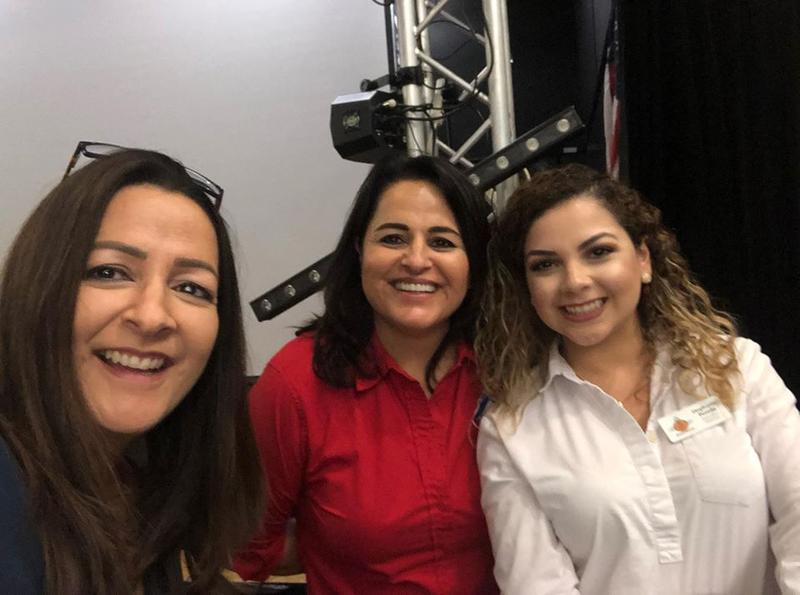 Somerton Chamber of Commerce staff including Angela Gallardo, center, of AV Realty LLC, and Executive Director Stephanie Pereda, right, at the 7th Annual Somerton Business Expo 2018 at the Cocopah Casino.