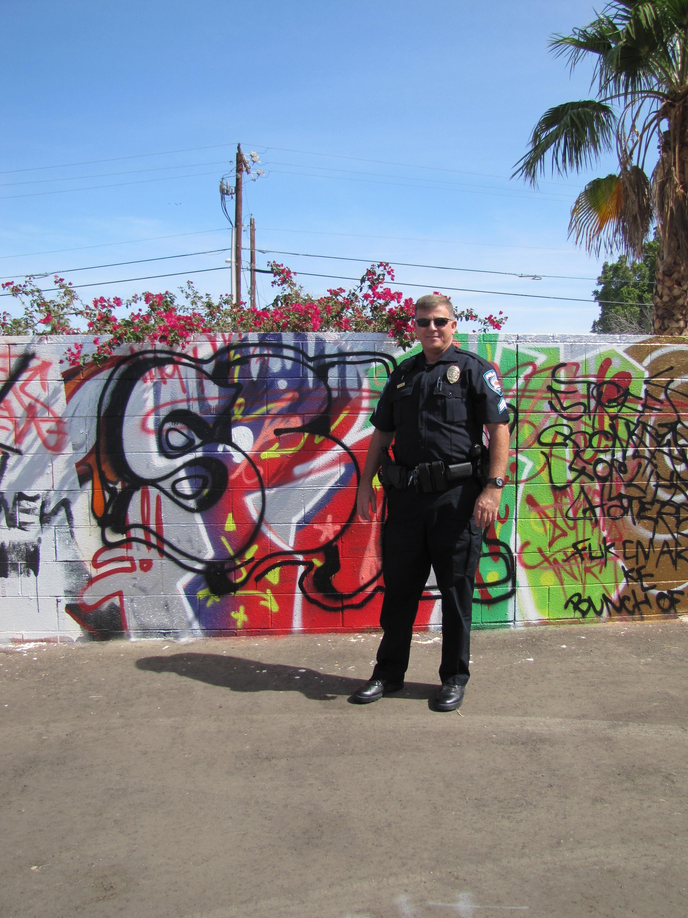 Graffiti wall activity - Sergeant Scott Legros In Front Of The Vertical Church Graffiti Wall