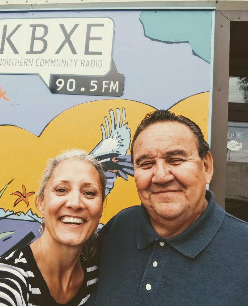 Niigaaniigwan (Bill) May with host Katie Carter outside the KBXE studio