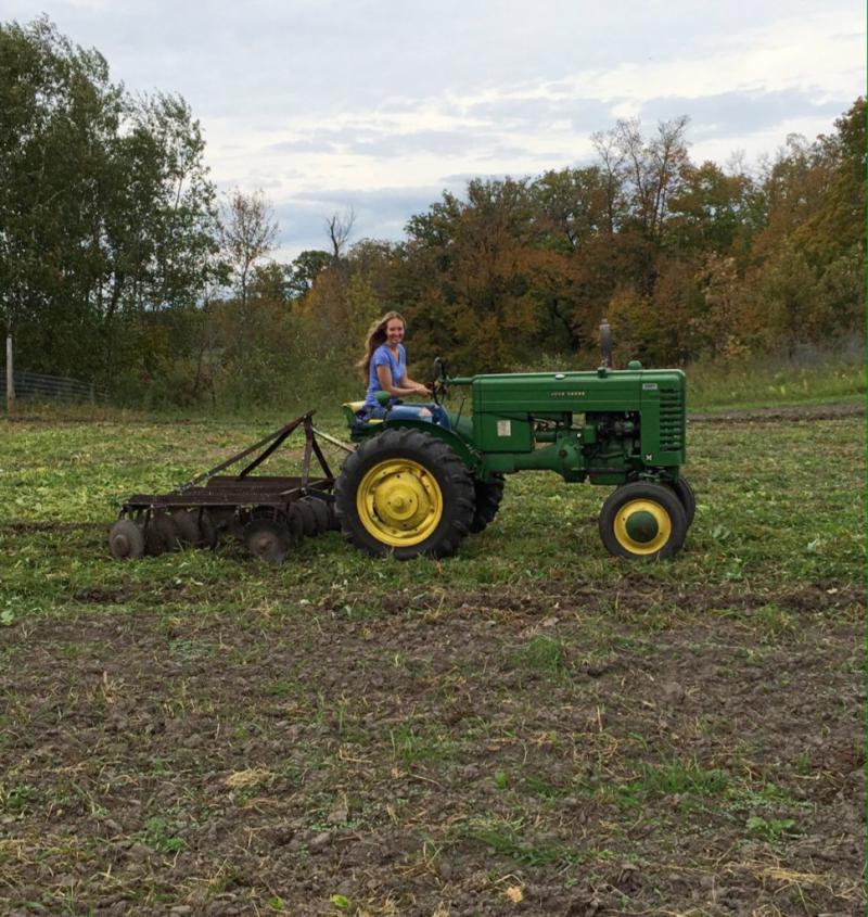 Anna Lauer on her tractor at Wildflower Farm