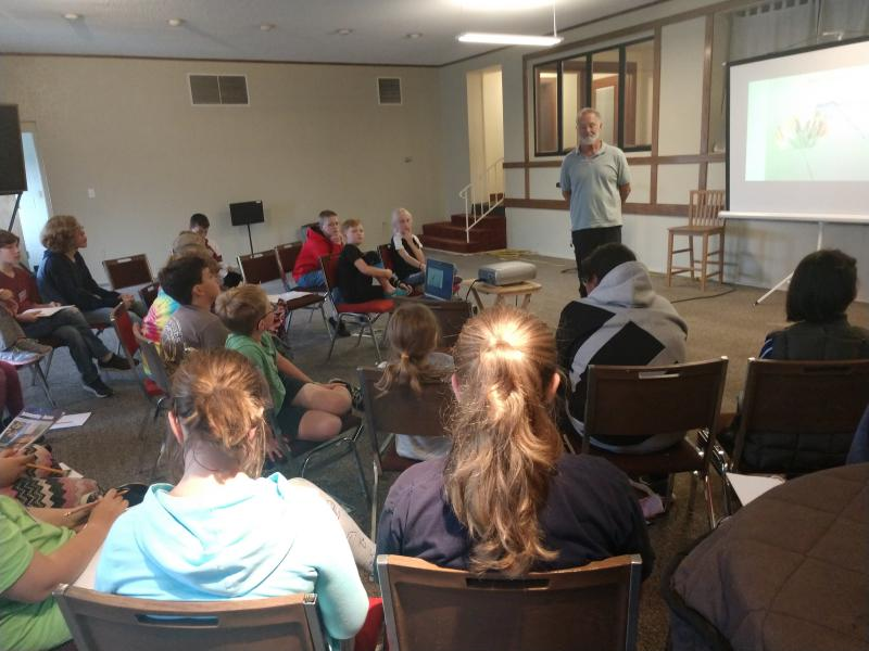 John Latimer discusses dragonflies with kids