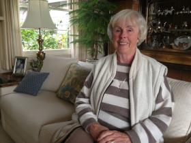 Village member Gerda sits in her Carmel Home.
