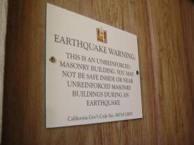 A sign at the Basilica alerts visitors to the unreinforced masonry.