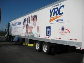 Christina's Smile mobile dental clinic parked at a golf course in Salinas.