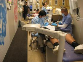 Local dentists and staff volunteering inside the Christina's Smile mobile dental clinic.