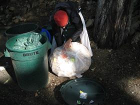 The Offset Project's Abbie Beane sorts through a bag of compost looking for contamination.
