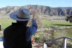 Mike Shields stands on his front porch and points to the steep slopes that condors often use to get aloft. The birds with a wingspan of as much as 9 feet and can fly from these peaks straight to Pinnacles National Park.