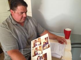 Jason Chelius looks through a folder of letters and pictures he plans to bring to the parole hearing.
