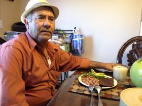 Abel Corona, 60, sits at his dining table at his Watsonville home. He has diabetes and is a student in a diabetes education class at Salud Para le Gente, a health clinic in Watsonville.