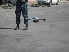 PSI's Instant Eye UAV hovers over the ground at Camp Roberts.