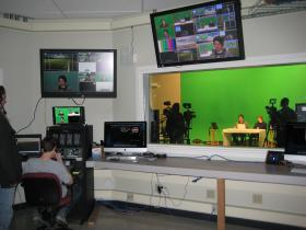 Millennium Charter High School students work in the television studio at the Media Center for Art, Education and Technology.
