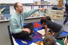 Teacher George Feldman works on math with a group of first graders at Ohlone Elementary School.