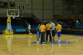 Warriors players huddle during a break in practice