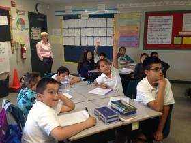 Students in Mr. Zamora's 5th Grade class eargerly participate in the weekly classroom meeting.  Olweus Program Coordinator Frances Weesner looks on.