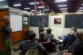 Bud Colligan fields questions at a tech meet-up held at a Santa Cruz startup where he is also an investor.