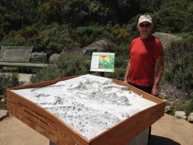 Gary Banta stands near his 3D dive model of the Point Lobos State Marine Reserve.  It's now on permanent display at Whaler's Cove.