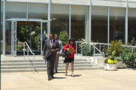 Attorney John Burris arrives for a press conference at City Hall.