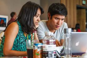 Isha Dandavate and Dan Tsai work on their winning mobile app at the Fishackathon at the Monterey Bay Aquarium