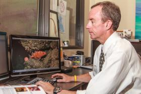 Dr. James Lindholm in a lab at the Institute for Applied Marine Ecology, CSUMB