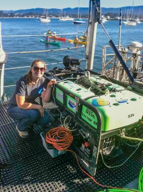 Megan Bassett and the ROV Beagle named for the ship that carried Charles Darwin to the Galápagos Islands.