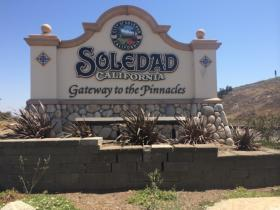 "A sign at the entrance to Soledad notes the city's branding effort as the ""Gateway to the Pinnacles""."