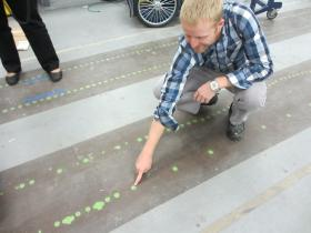 "Lee Redden points to ""lettuce"" on the test strip in the workshop at Blue River's Mountain View headquarters."