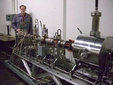 Dr. William Colson stands next to a component of the Free Electron Laser recently acquired by the Naval Postgraduate School.