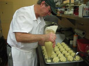 Hartnell College Food Service Manager Mike Cunnane makes duchess potatoes for a meal inspired by French cuisine.