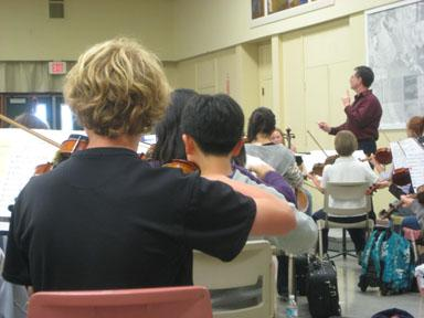 "The Youth Music Monterey Honors Orchestra prepares for the ""All Together Now Concert\""."