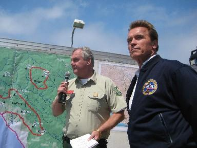 Governor Schwarzenegger arrives to a briefing on the Basin Complex Fire.