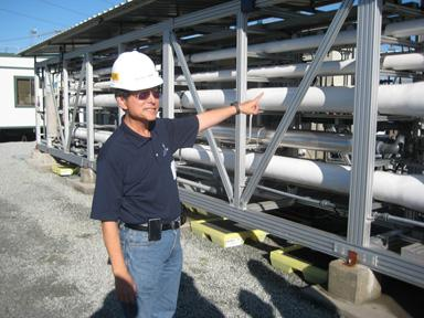 Peter Shen of California American Water points out the reverse osmosis system at the desalination pilot plant in Moss Landing.