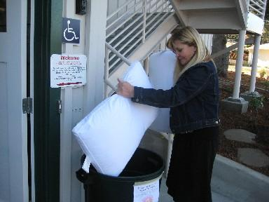 Terry Ballantyne looks to see what's been dropped off in a collection bin outside of the Aptos/La Selva Fire Station, number 2.
