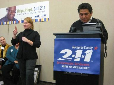 Salinas City Councilman Sergio Sanchez places the first call to the Monterey County 211 line.